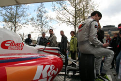 Fans Look at Car