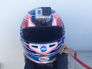 "Attached to Michael Lewis' Bell HP7 Carbon Helmet is this GoPro Hero 3+ Black Edition Camera, which provides an ""eye level"" perspective of driving a Porsche 911 GT3 Cup Car."