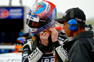 Michael Lewis straps on his helmet before climbing in to the No. 98 Competition Motorsports/Curb-Agajanian Porsche 911 GT3 Cup car on Sunday, May 4. Photo by Blake Blakely.