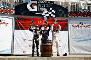 Earning his third podium of the 2014 IMSA GT3 Cup Challenge USA by Yokohama race season, Michael Lewis (left) holds his trophy proudly for his third-place finish during the weekend's Race 1 on Friday, June 27, at Watkins Glen International.