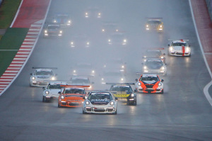 Friday's Race 1 began under wet conditions with Michael Lewis' No. 98 Competition Motorsports/Curb-Agajanian Porsche 911 setting the pace of the field as he led from the green to the checkered flag.