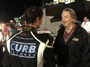 Mike Curb, on right, owner of Curb Records, and supporter and sponsor of Michael Lewis, speaks to Michael after Michael's strong performance in Friday's Race 2.
