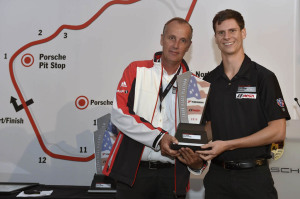 Michael Lewis receives a trophy for finishing third this season in the IMSA Porsche GT3 Cup Challenge USA by Yokohama from Eric Bloss, special projects manager at Porsche Motorsport North America.