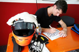 Michael Lewis is seen here studying the  track layout before taking a Porsche onto the course.