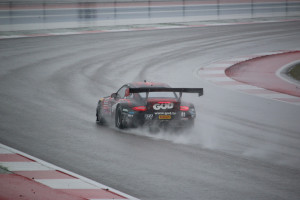 Undaunted by adverse weather conditions for Race 2 of the Pirelli World Challenge, Michael Lewis methodically passed cars from his 12th starting position on Sunday, March 8, to finish the race in 9th overall, but claimed the top podium position in the GTA class.