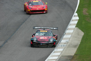 Michael Lewis is seen here at Barber Motorsports Park in the No. 41 EFFORT Racing Porsche 911 GT3 R as he leads a competitor.