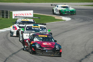 Michael Lewis leads a pack of cars in Round 7 of the Pirelli World Challenge at Barber Motorsports Park on Sunday, April 26, 2015. He finished the race in P6.