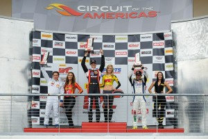 Michael Lewis on the Race 1 podium at Circuit of The Americas.