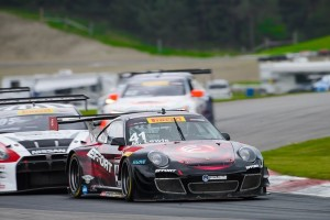 Michael Lewis and the No. 41 EFFORT Racing/Curb-Agajanian Porsche 911 GT3 R lead a pack of cars on Saturday, May 17. Michael finished the race in 8th position.