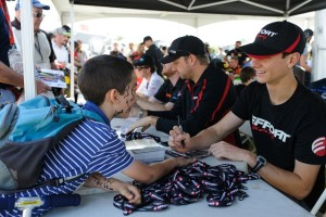 Michael Lewis enjoys interacting with fans, and he gladly offers his autograph to this young fan at Canadian Tire Motorsport Park.
