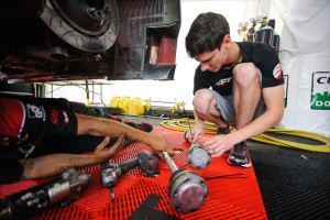 Michael Lewis stays busy both on and off the track during race weekends. Here, he helps an EFFORT Racing team member who is working on the No. 41 EFFORT Racing/Curb-Agajanian Porsche 911 GT3 R.