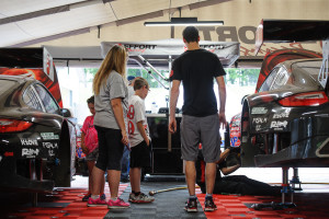 Fans are always welcome at EFFORT Racing. Here, Michael Lewis gives a tour of the paddock area and the No. 41 EFFORT Racing/Curb-Agajanian Porsche 911 GT3 R.