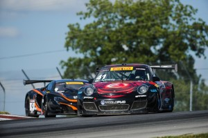Michael Lewis holds off a challenge by Kevin Estre to earn his third consecutive 5th-place finish in Round 14 of the Pirelli World Challenge, on Saturday, August 1.