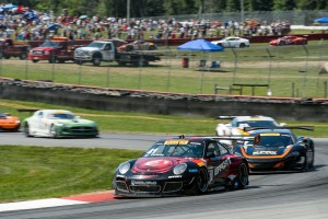 Michael Lewis is seen here during the Pirelli World Challenge Round 15 when he was part of a pack of cars challenging for position.