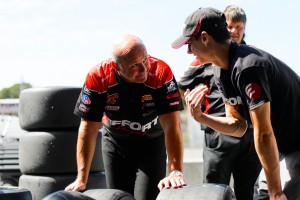 Michael Lewis confers with EFFORT Racing Team Engineer Stefan Pfeifer as they prepare for Round 20 of the Pirelli World Challenge.