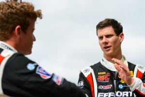 Michael Lewis discusses race strategy with EFFORT Racing teammate Patrick Long.