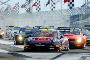 Michael Lewis leads the field of GT, GTA and GT Cup competitors into Turn 1 of Round 3 of the Pirelli World Challenge.