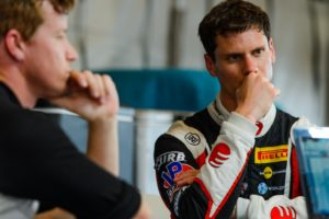 Michael Lewis and EFFORT Racing teammate Patrick Long consider race strategy after qualifying for the Grand Prix of Birmingham presented by Porsche, on Saturday, April 23.
