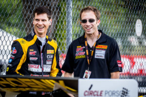 Michael and Calvert Dynamics team member Andrew Aquilante relax before the start of the race at Mid-Ohio Sports Car Course.