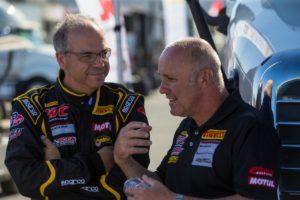 Preston Calvert and Stefan Pfeiffer discuss race strategy prior to the start of a SprintX race at Mazda Raceway Laguna Seca.